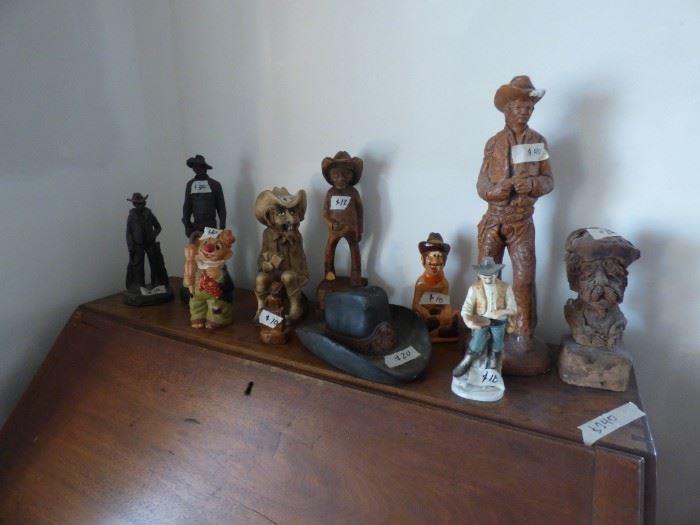 Cowboy statues.