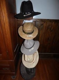 Cowboy hats and a hat rack.