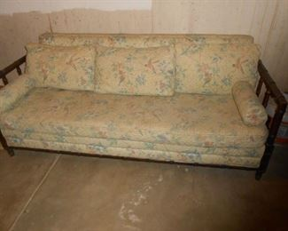 A solid wood sofa in the basement (walk out)