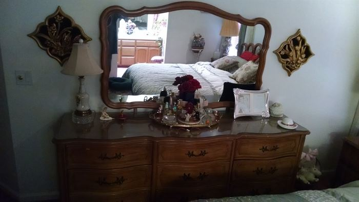 brown French provincial dresser with mirror, dresser set