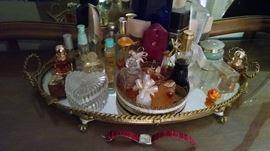 perfume bottles , vanity mirror