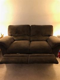 Brown couch and it reclines