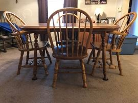 Table with an extra extension and 4 chairs