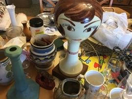 60-70's wig/hat stand amid lots of collectibles. Wormwood pitcher. Van Briggle candlesticks
