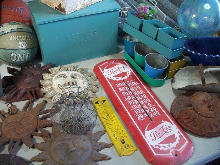 Pepsi thermometer and cast iron garden decor