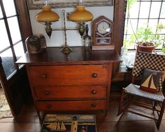 Double student lamp on early chest of drawers.