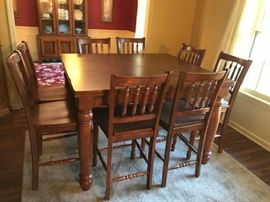#1 tall table with 8 chairs and built in leaf 48-60x48x36 350.00