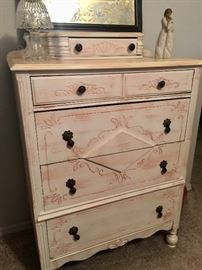 Beautifully refinished antique chest of drawers.