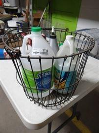 Metal basket w cleaning supplies.