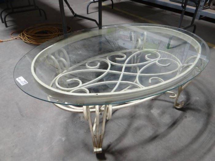 Metal frame coffee table w glass top.