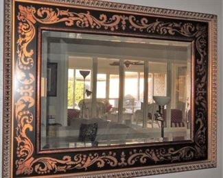 large black and gold stenciled frame mirror
