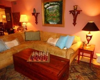 Living Room. Needs Repair..Low PRICE, Sectional Sofa.!! Vintage Cedar Trunk Coffee Table, Vintage Various Table Lamps
