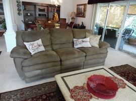 Micro fiber sofa with reclining ends.  Mid brown color