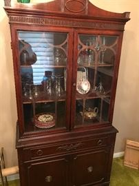 Beautiful China cabinet of in a smaller manageable size. Filled with quality stemware!