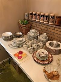 Steins and mugs along with numerous dish sets!
