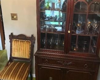 Nice medium sized china cabinet and chair! The cabinet is fill with quality stemware!