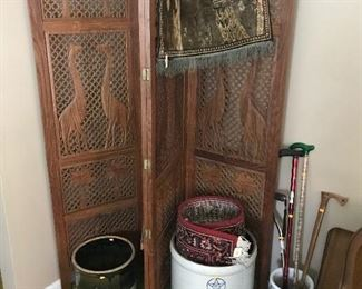 Large carved folding screen behind a couple old crocks and planters!