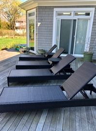 Four outdoor wicker lounge chairs & cushions