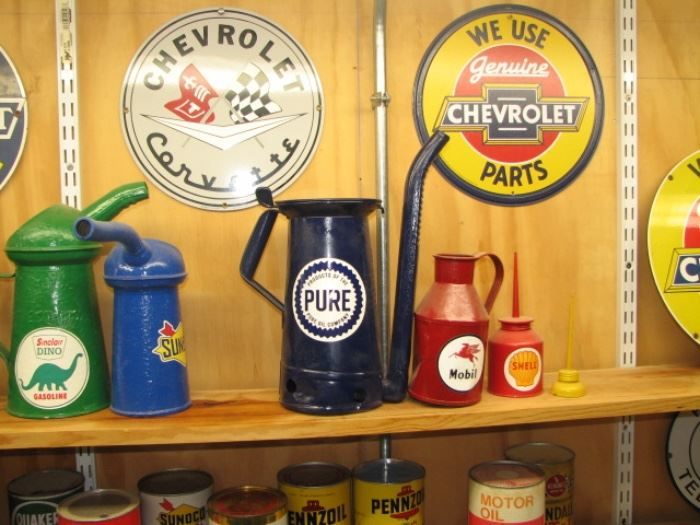 Vintage oil cans and advertising signs