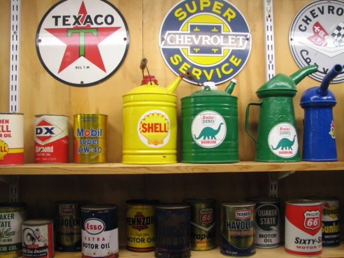 Vintage oil cans, advertising and petroleum signs