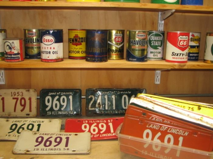 Vintage oil cans and license plates