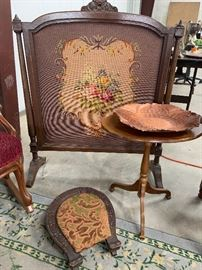 Needlepoint artwork and small footstool