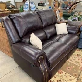 Leather loveseat recliner - less than one year old