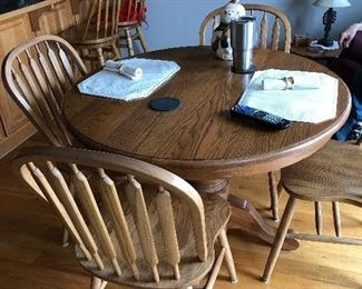 The perfect dining table and 4 chairs with one leaf for a small dining room or breakfast area.