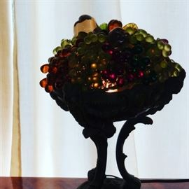 My favorite item on this sale  Great glass fruit lamp with iron base with rams heads