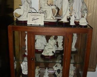 Giuseppie Armani figurines and display case