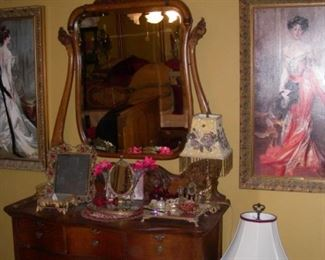 More architectural fretwork, wishbone mirrored dresser, plateaus, lamps, decorative art