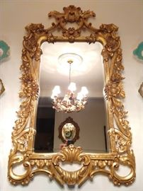 Beautifully detailed gilt wood wall mirror, with beveled glass.