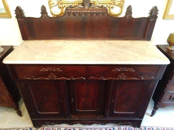 Wonderful Victorian mahogany sideboard, with white marble top, carved backsplash, two drawers and three doors.