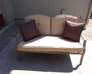 Patio set with loveseat and two chairs, coffee table