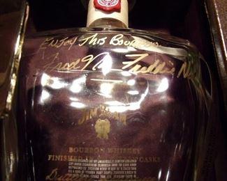 Empty, signed liquor bottles.