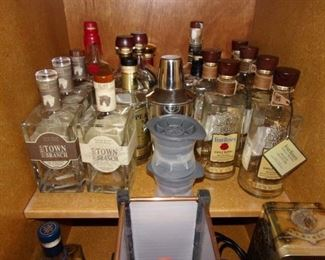 Empty, signed liquor bottles, some in boxed sets.