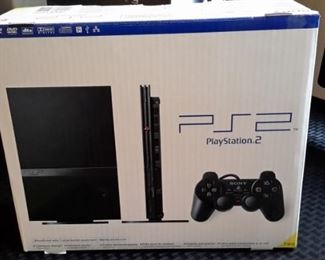 Playstation 2, like new, in box.