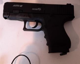 Six airsoft pistols, with targets and pellets.