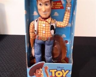 Toy Story's Pull-String Talking Woody, new in box. Works.