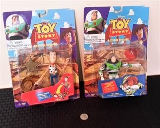 Toy Story Woody and Buzz Lightyear action figures, new in box.