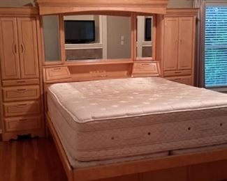 California King mattress and box 18 inches extra deep(lightly stained) with  2 twin box springs (mattress cover has protected it) with lighted headboard with side storage, and base with pedestal drawers...tons of storage!