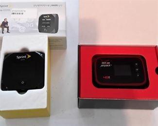 Sprint Mobile Hotspot and Verizon Jetpack, in box.