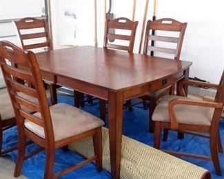 Stunning table top dining room table with drawer and 6 ladder back chairs(2 are captain)