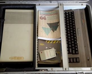 Vintage Macintosh Commodore 64! Comes with CPU, keyboard, mouse, two joysticks, manuals, chords and carrying case!