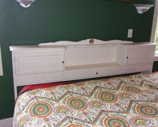 King sized headboard with storage (bed and linens not for sale.)