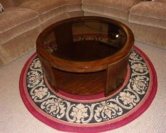 MCM round coffee table and pretty round rug.