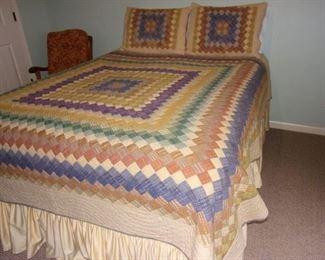 Handmade Queen quilt and 2 shams.