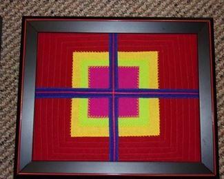 Framed textile artwork.