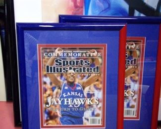 Framed Jayhawks Sports Illustrated covers.
