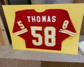 "Unframed ""Thomas"" jersey."